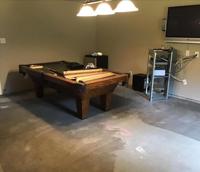 Game room with pool table against wall